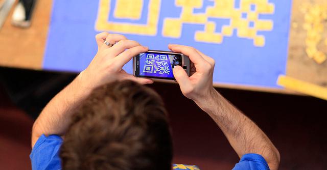 man scanning qr code